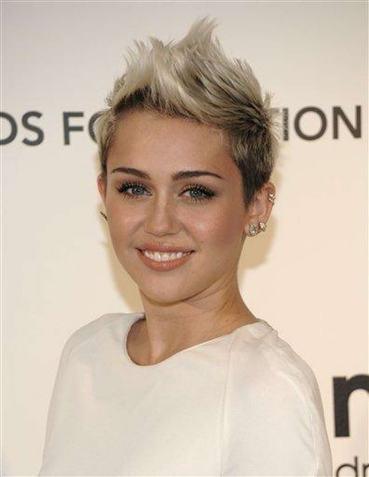Singer and actress Miley Cyrus arrives at the 2013 Elton John Oscar Party in West Hollywood, Calif. on Sunday, Feb. 24, 2013. (Dan Steinberg/Invision/AP)