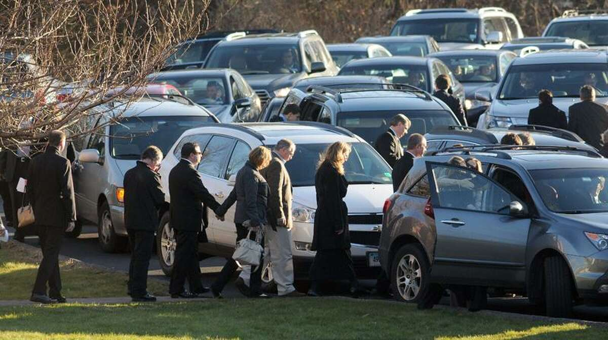 Mourners leave Charlotte Bacon's funeral at Christ the King Lutheran Church, Newtown. Mara Lavitt/New Haven Register12/19/12