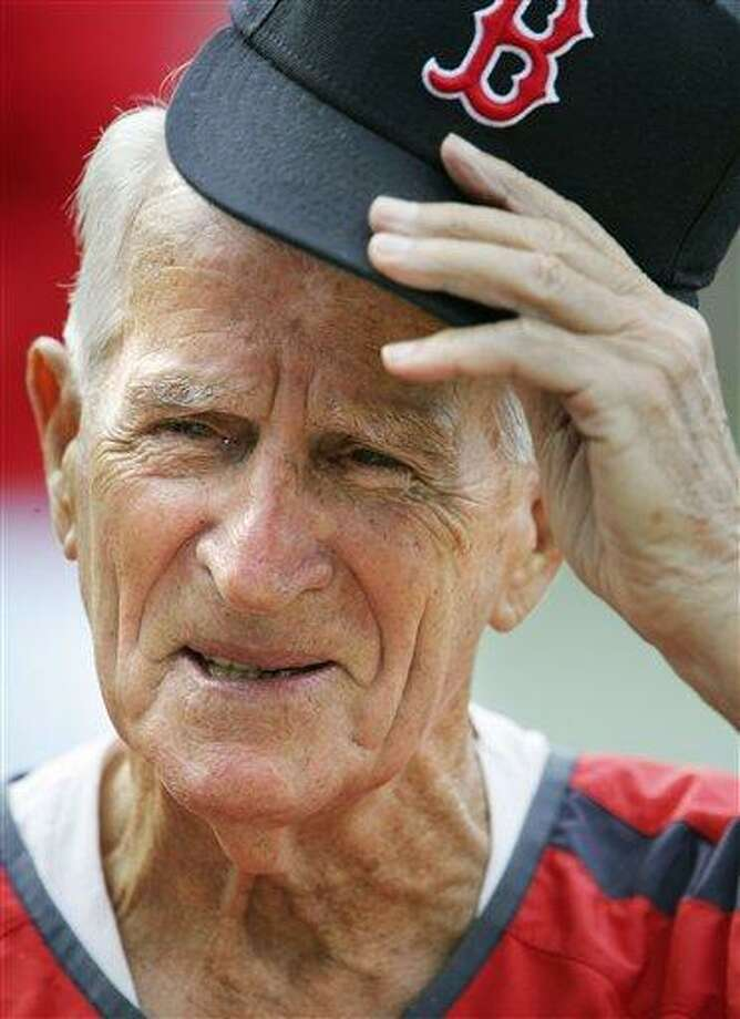 FILE - In this Aug. 31, 2006, file photo, Boston Red Sox great Johnny Pesky lifts his cap during a television interview before a baseball game against the Toronto Blue Jays in Boston. Pesky, who spent most of his 60-plus years in pro baseball with the Red Sox and was beloved by the team's fans, has died on Monday, Aug. 13, 2012, in Danvers, Mass. He was 92. (AP Photo/Michael Dwyer, File) Photo: AP / AP