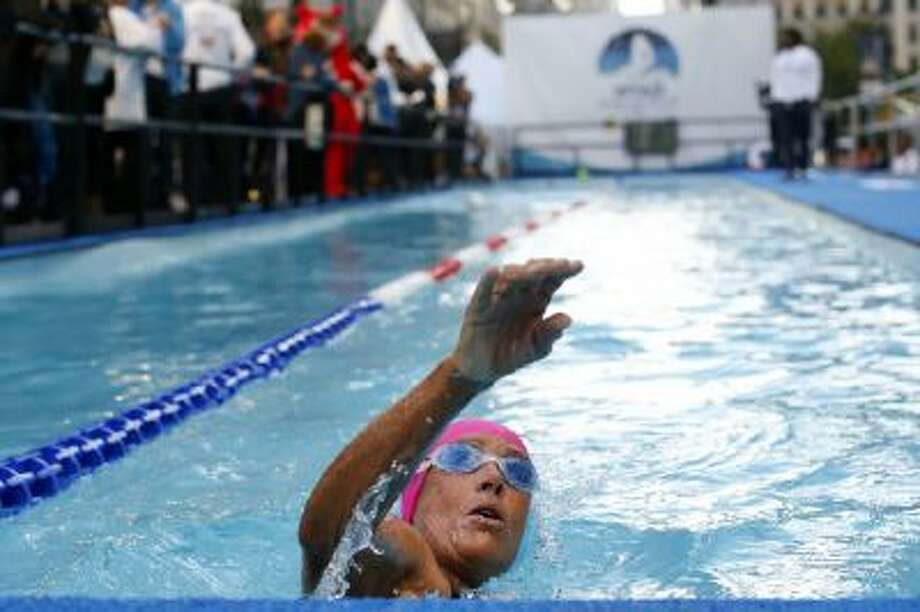 "Long-distance swimmer Diana Nyad, who recently completed a record-breaking swim from Cuba to Florida, completes a lap during a continuous 48-hour swim event in New York's Herald Square called ""Swim for Relief,"" which aims to raise funds and awareness for Hurricane Sandy recovery efforts."