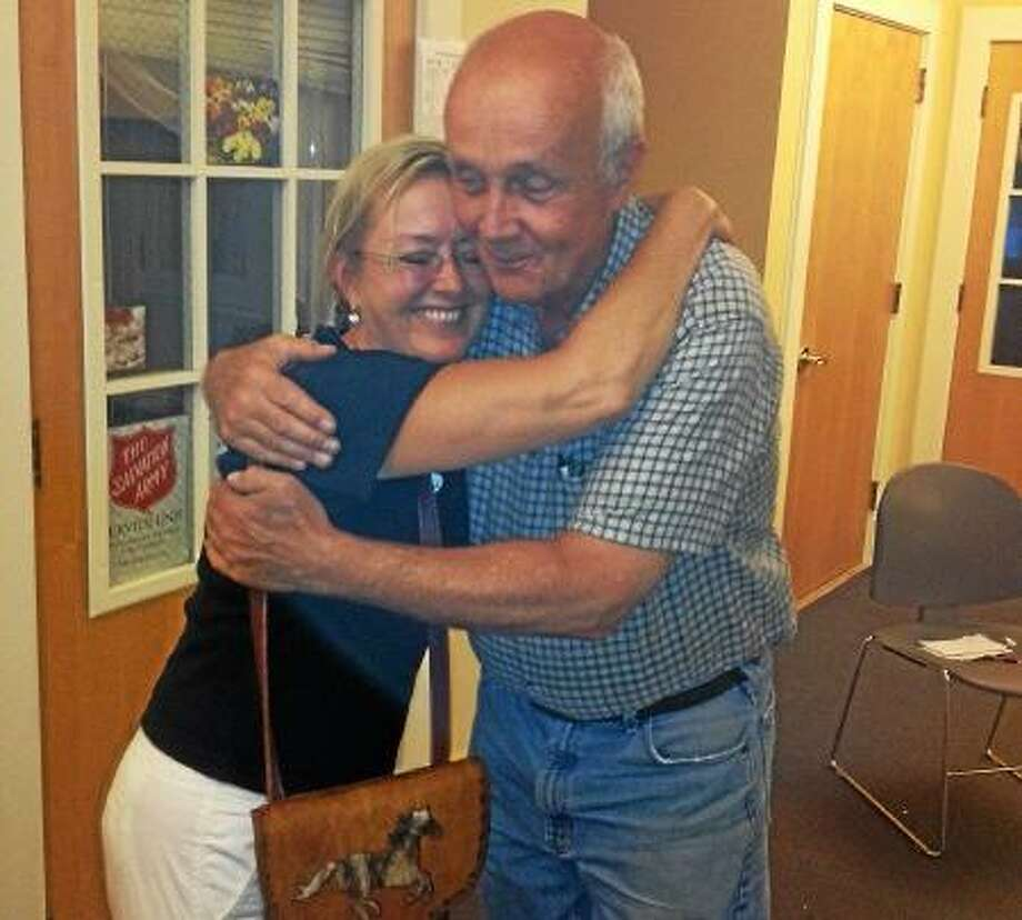 Long-time Middlefield resident Lori Vogel-Brown and Middlefield First Selectman Jon Brayshaw share a congratulatory hug after voters approved of the sale of the remaining 19.67 acres of Powder Ridge Ski Area property on Tuesday in Middlefield. Vogel-Brown is purchasing the land for $300,000 in cash.  (Mike T. Lyle - The Middletown Press)
