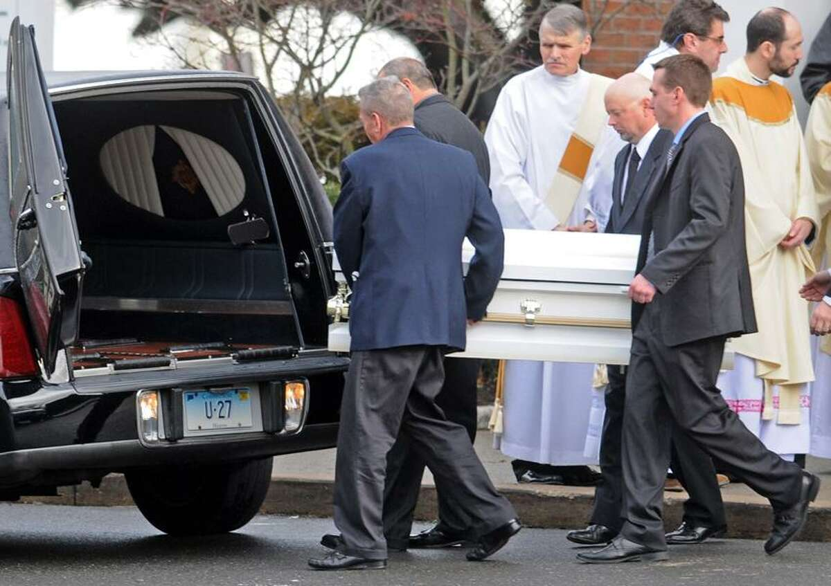 Pallbearers bring the casket of Jessica Rekos, 6, of Newtown to the hearse during her funeral at the St. Rose of Lima Roman Catholic church Tuesday morning December 18, 2012. Rekos was killed by a gunman who also claimed the lives of 6 adults and 19 other children at the Sandy Hooky Elementary School shooting Friday, December 15, 2012. Photo by Peter Hvizdak / New Haven Register