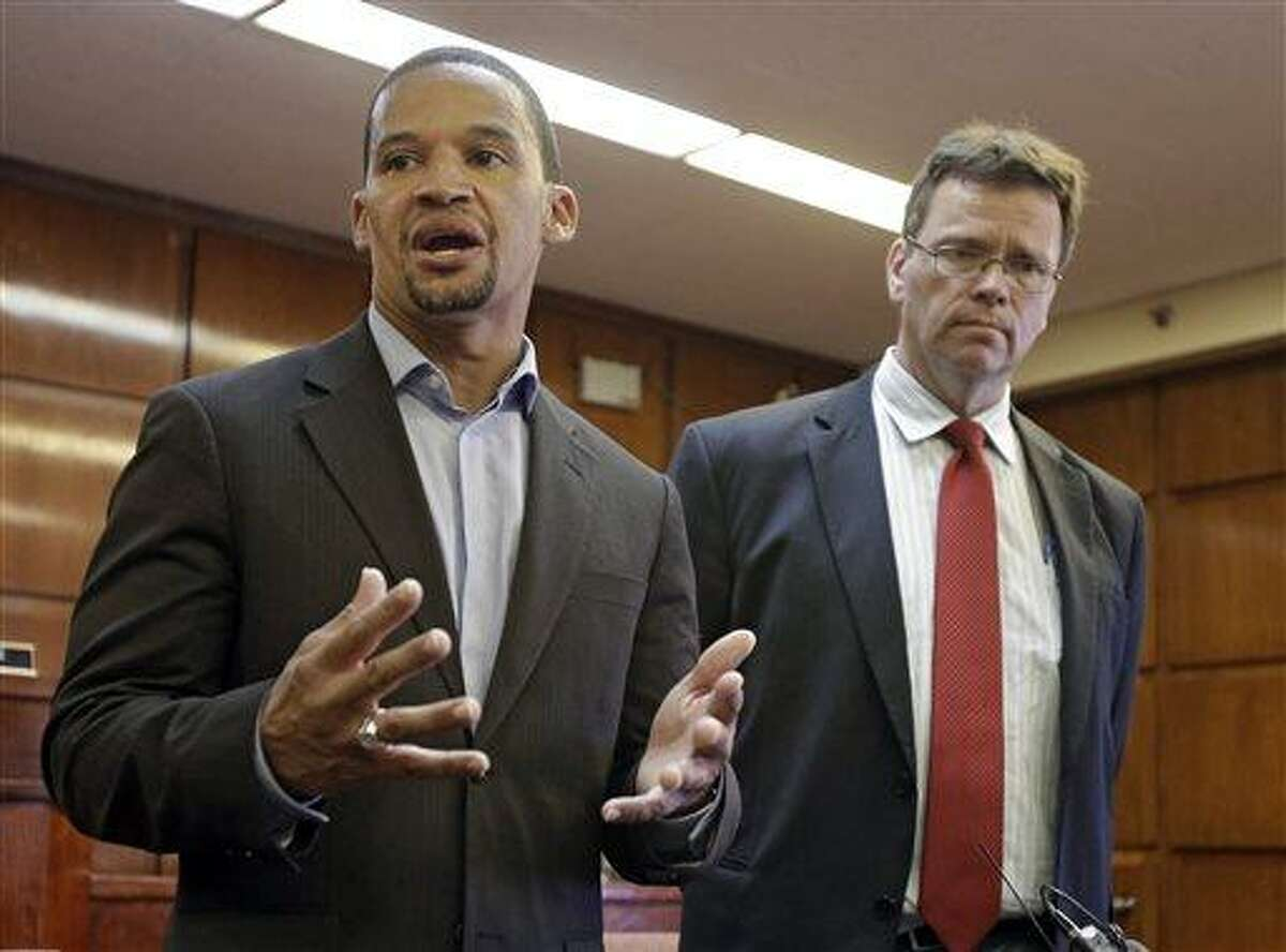 East Cleveland Mayor Gary Norton, left, speaks during a news conference with Cuyahoga County Medical Examiner Dr. Thomas Gilson, in East Cleveland, Ohio, Tuesday, July 23, 2013. Norton announced that Shetisha Sheeley, 28, has been identified as the second of three murdered women found in trash bags in the city. The body of Shetisha Sheeley, 28, of Cleveland, was found in a field on Saturday, July 20, said Norton. (AP Photo/Mark Duncan)