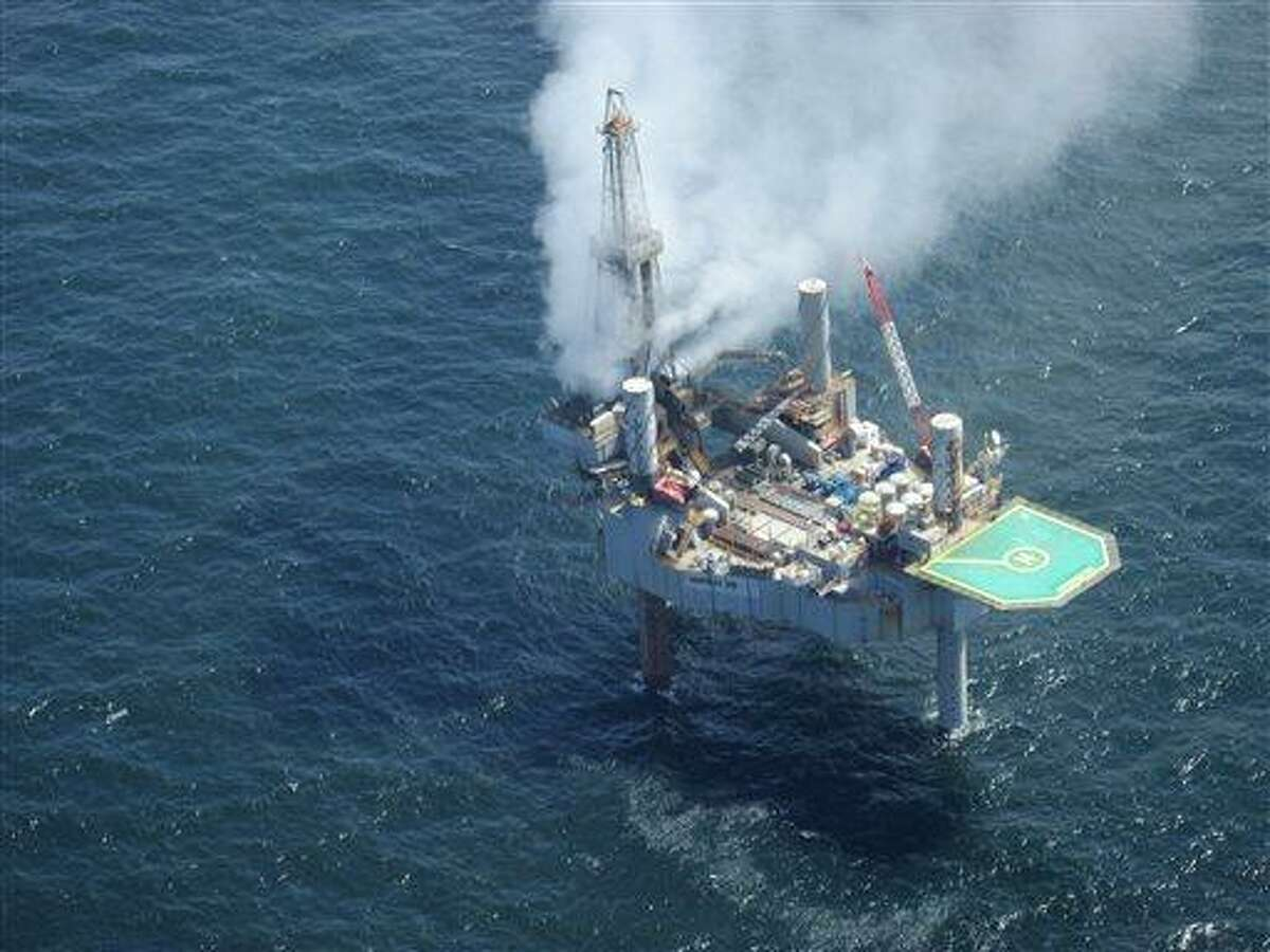 This photo released by the Bureau of Safety and Environmental Enforcement shows natural gas spewing from the Hercules 265 drilling rig in the Gulf of Mexico off the coast of Louisiana, Tuesday, July 23, 2013. No injuries were reported in the midmorning blowout and there was no fire as of Tuesday evening at the site, about 55 miles off the Louisiana coast in the Gulf of Mexico. (AP Photo/Bureau of Safety and Environmental Enforcement)