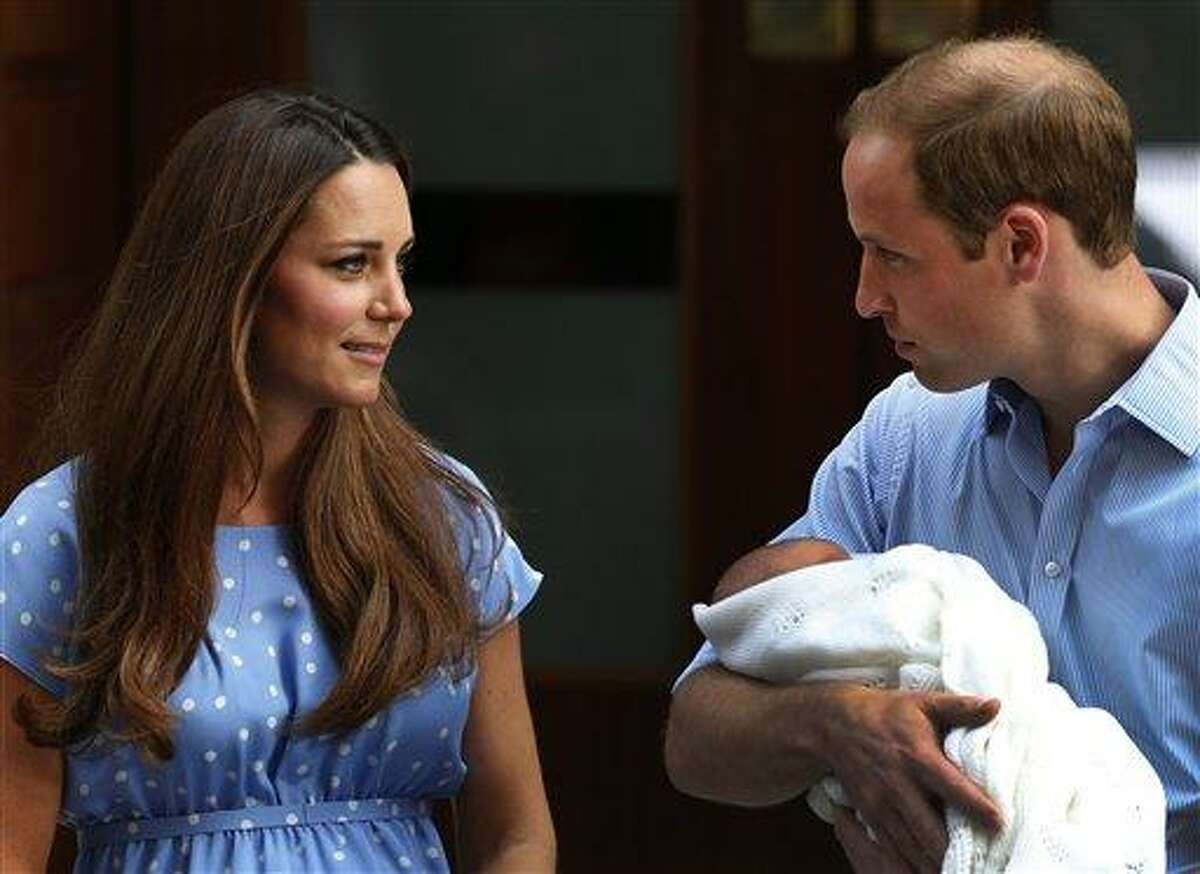 Britain's Prince William holds the Prince of Cambridge, Tuesday, July 23, 2013, as he and his wife Kate, Duchess of Cambridge pose for photographers outside St. Mary's Hospital exclusive Lindo Wing in London where the Duchess gave birth on Monday. The royal couple presented their newborn son to the world for the first time Tuesday, drawing whoops and wild applause from well-wishers as they revealed the new face of the British monarchy - though not, yet, his name. (AP Photo/Lefteris Pitarakis)