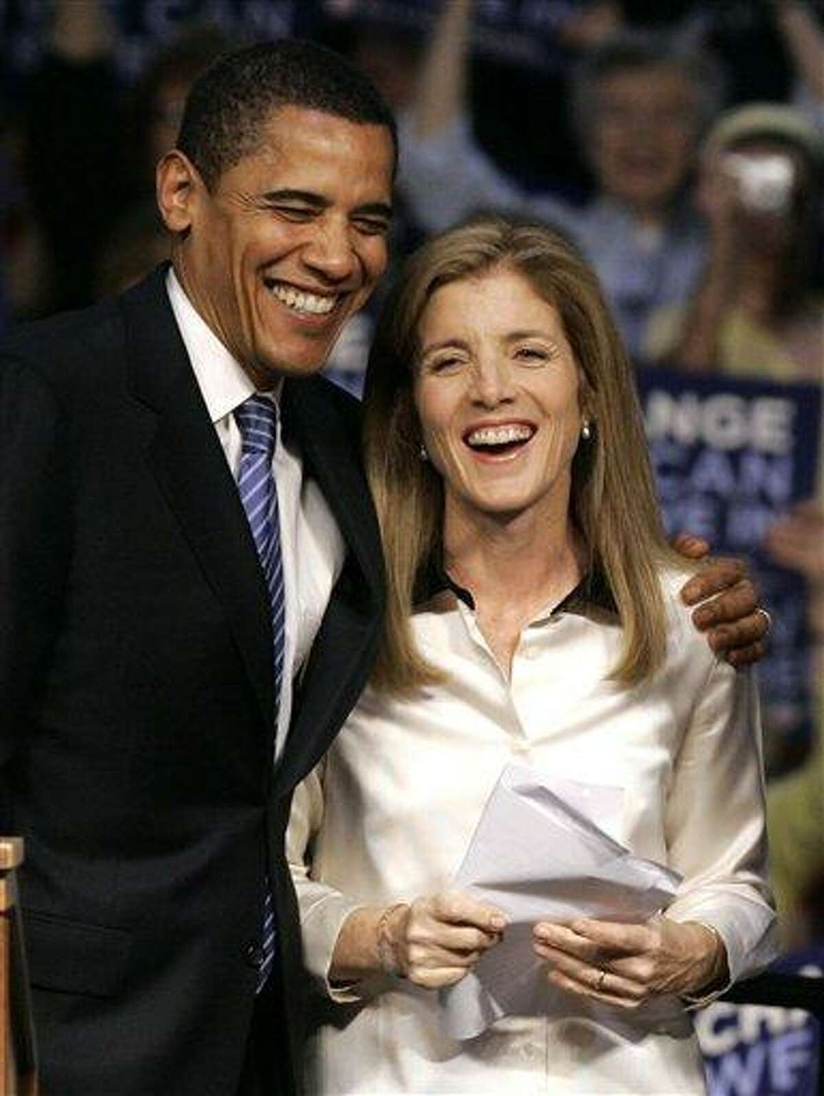 In this April 20, 2008 file photo, then-Democratic presidential candidate Sen. Barack Obama, D-Ill. shares a moment with Caroline Kennedy before addressing supporters at a rally in Scranton, Pa. AP sources say Obama is nominating Kennedy as ambassador to Japan. (AP Photo/Charles Rex Arbogast, File)