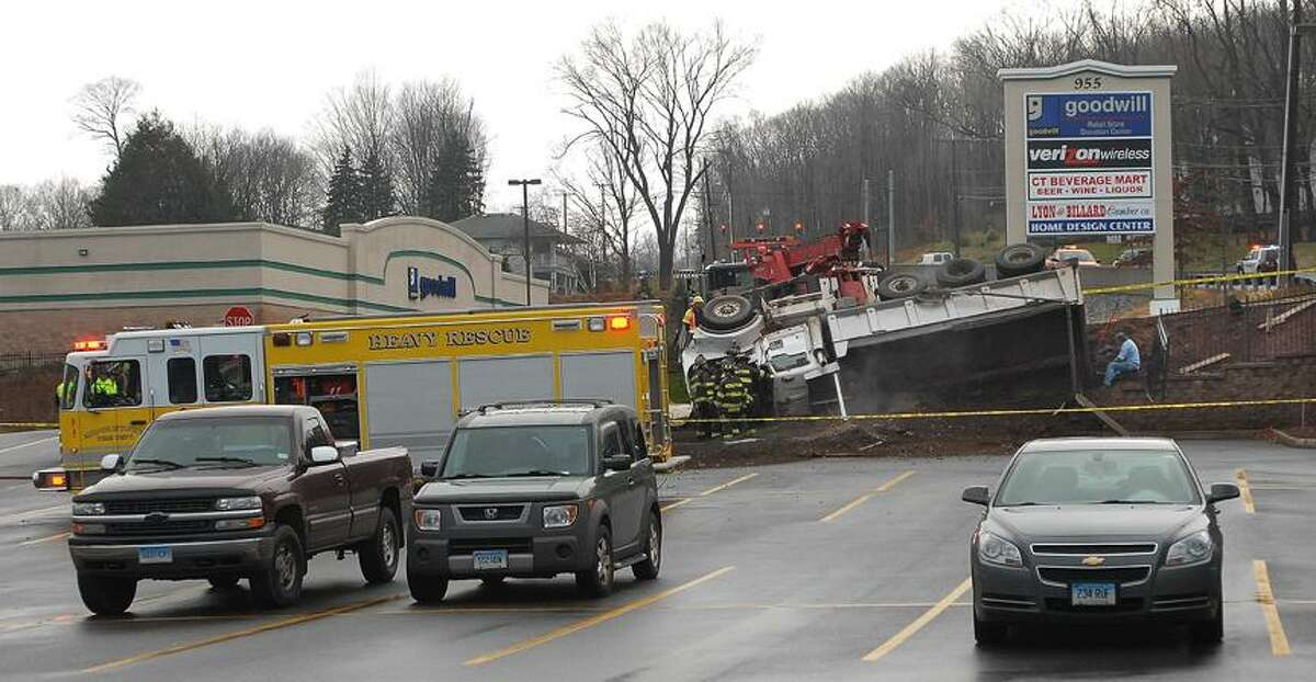 Catherine Avalone/The Middletown PressMiddletown firefighters are at the scene of a fatal crash on Washington Street in Middletown involving a dump truck and a four door sedan.