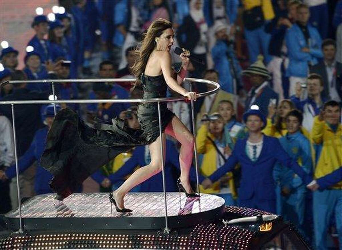 Posh Spice of the the British pop group Spice Girls performs during the Closing Ceremony at the 2012 Summer Olympics, Sunday, Aug. 12, 2012, in London. (AP Photo/Martin Meissner)