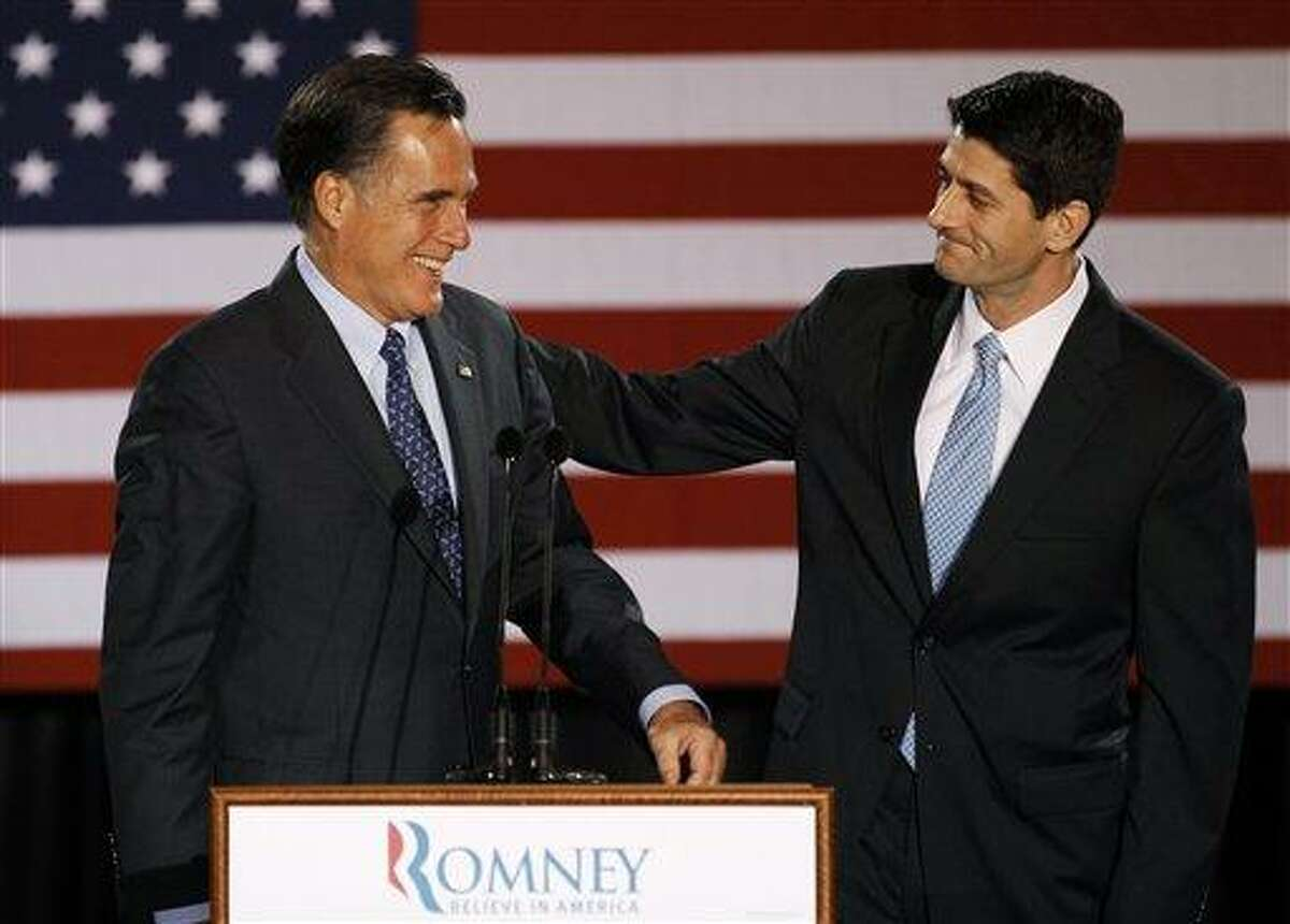 House Budget Committee Chairman Rep. Paul Ryan, R-Wis. introduces Republican presidential candidate, former Massachusetts Gov. Mitt Romney, before Romney spoke at the Grain Exchange in Milwaukee, in this April file photo.