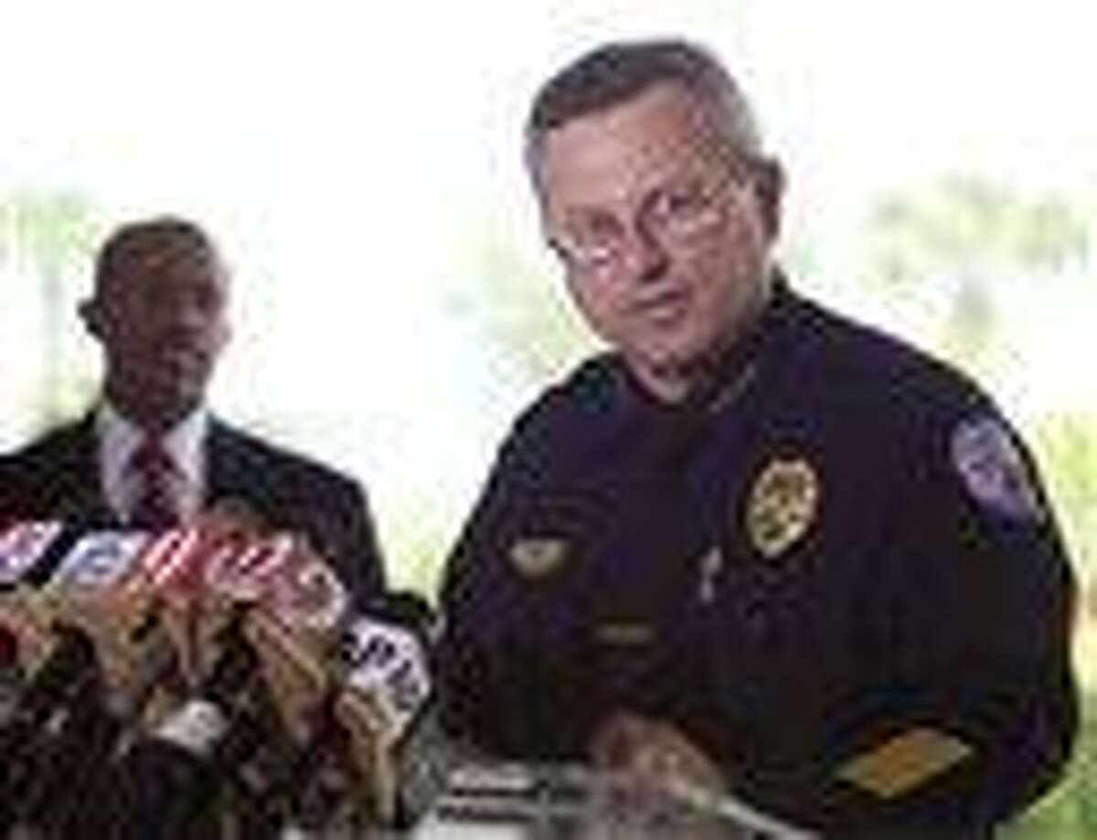 In this March file photo, Sanford Police Chief Bill Lee speaks to the the media during a news conference as city manager Norton Bonaparte Jr. listens at left, in Sanford Fla. Associated Press