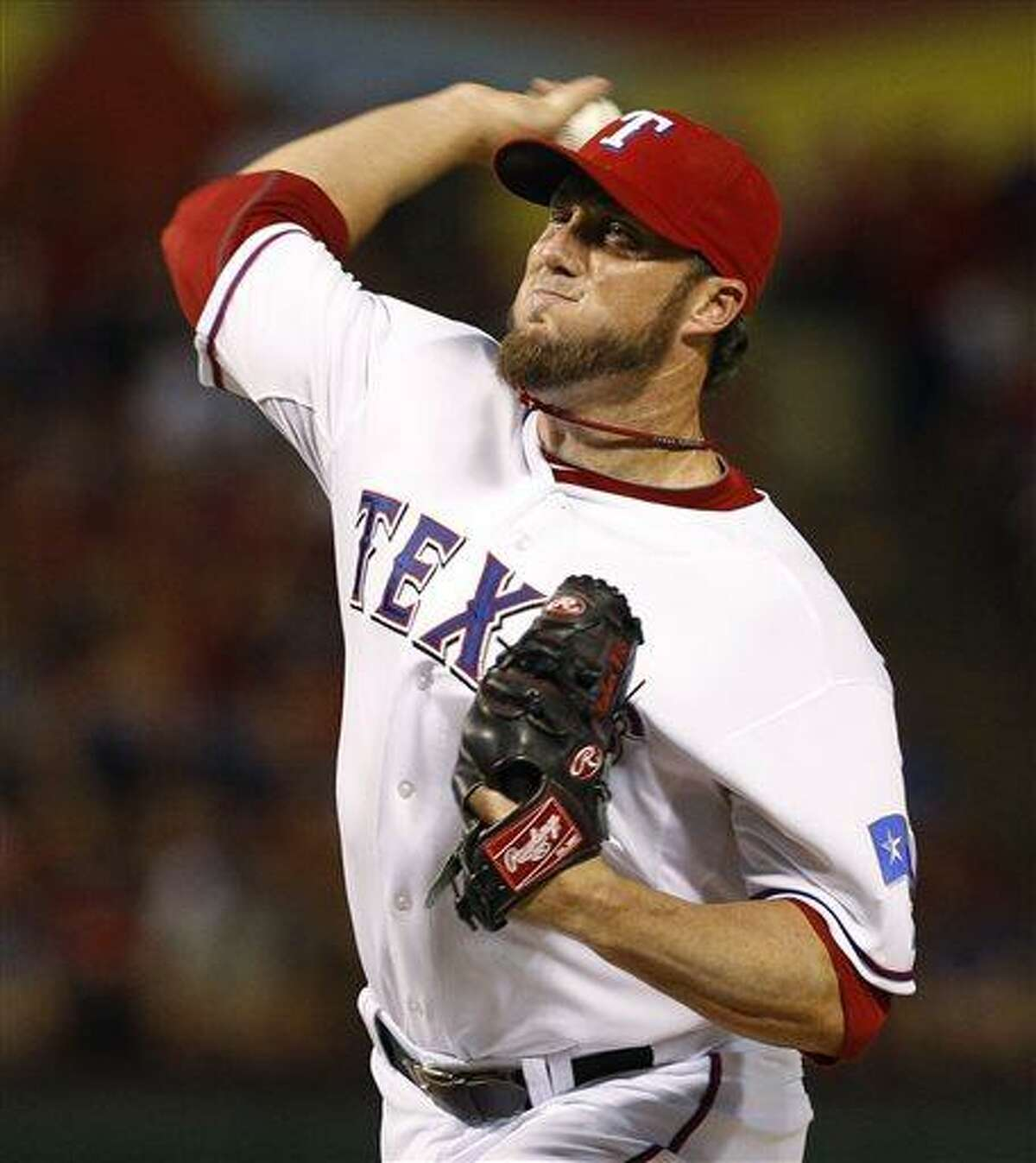 Texas Rangers relief pitcher Joe Nathan throws to the New York Yankees during the ninth inning of a baseball game, Wednesday, July 24, 2013, in Arlington, Texas. The Rangers won 3-1. (AP Photo/Jim Cowsert)