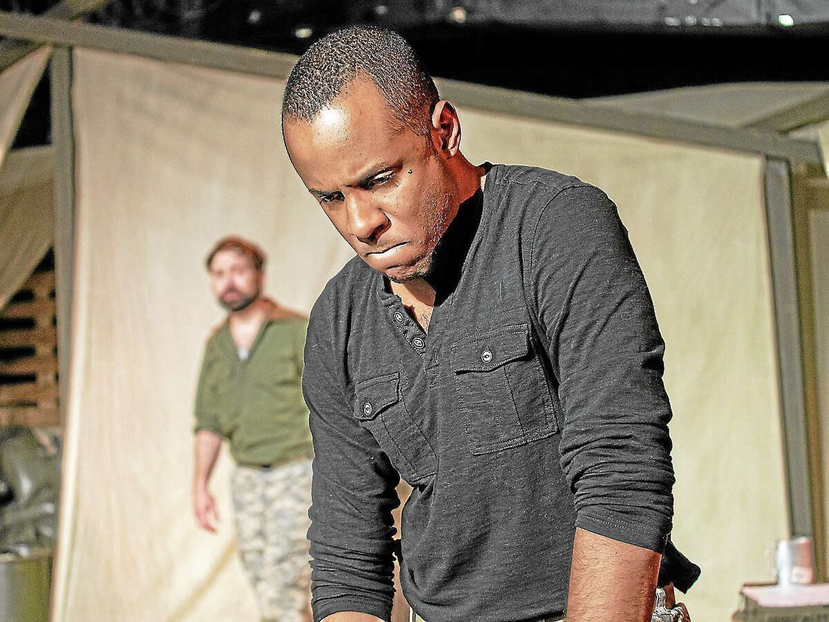 Submitted photos - Playhouse on ParkTom Coiner as Iago, in the back, and RJ Foster as Othello perform a dramatic scene in