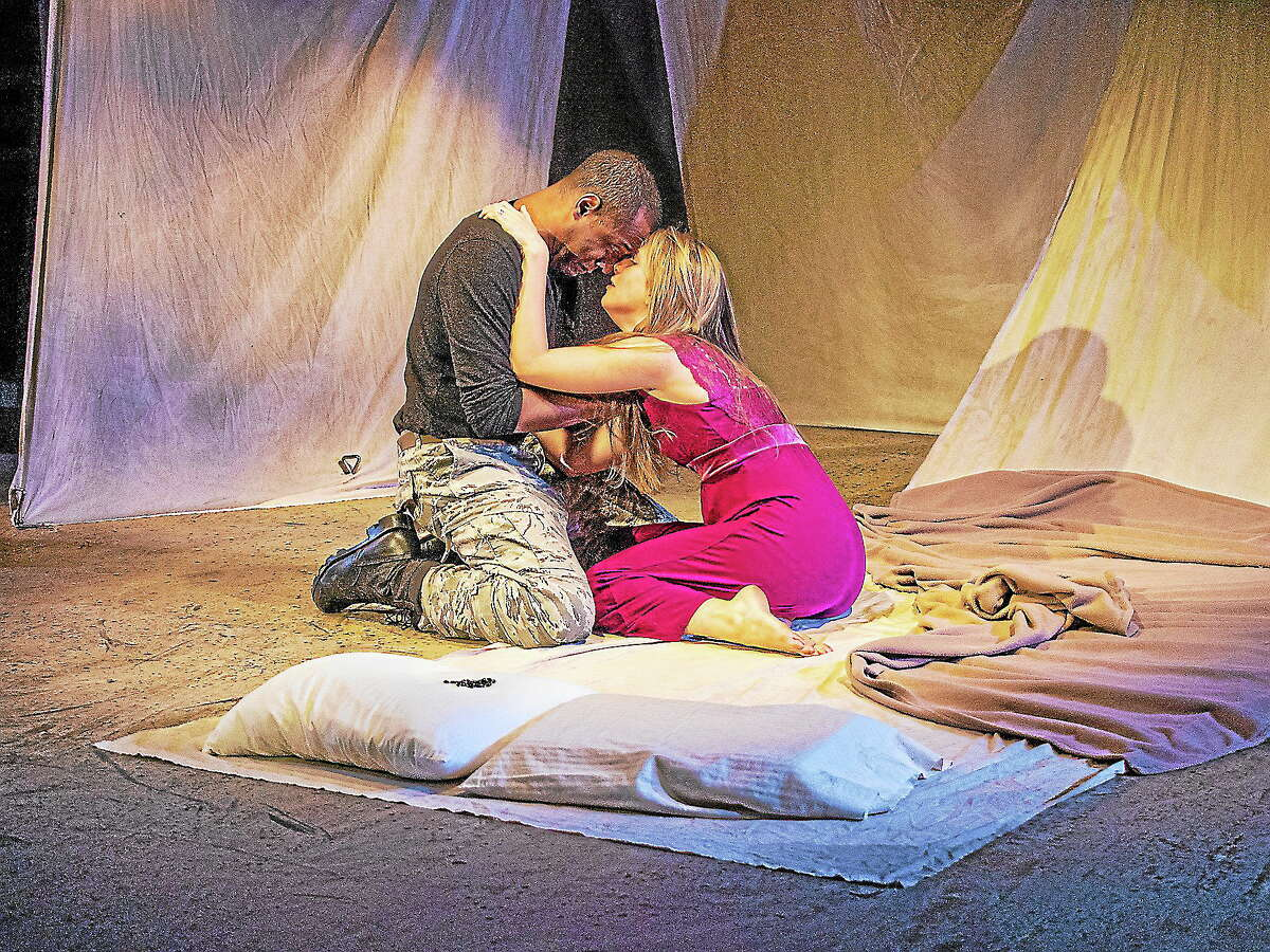 Submitted photo - Playhouse on ParkRJ Foster's Othello is at once a powerful leader and equally an all-too-human man who surrenders to the fault of jealousy. His beautiful wife Desdemona, the faithful and constant Celine Held, is cast in the role of seductress.