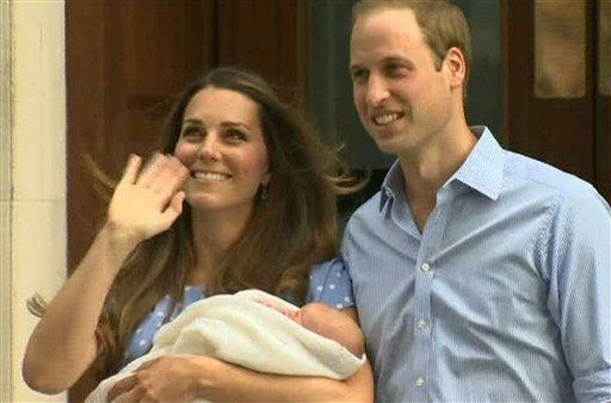 In this image from video, The Duke and Duchess of Cambridge leave the Lindo Wing of St Mary's Hospital in London Tuesday July 23 2013, carrying their new-born son, the Prince of Cambridge who was born Monday, into public view for the first time. The boy will be third in line to the British throne. (AP Photo/APTN)