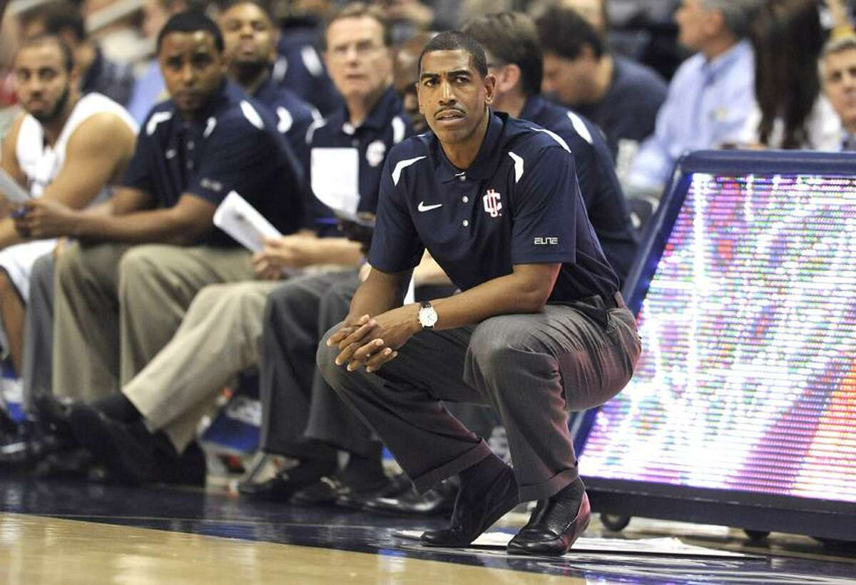 Connecticut head coach Kevin Ollie watches play during the first half of a men's NCAA basketball game against American International College in Storrs, Conn., Thursday, Nov. 1, 2012. (AP Photo/Jessica Hill)