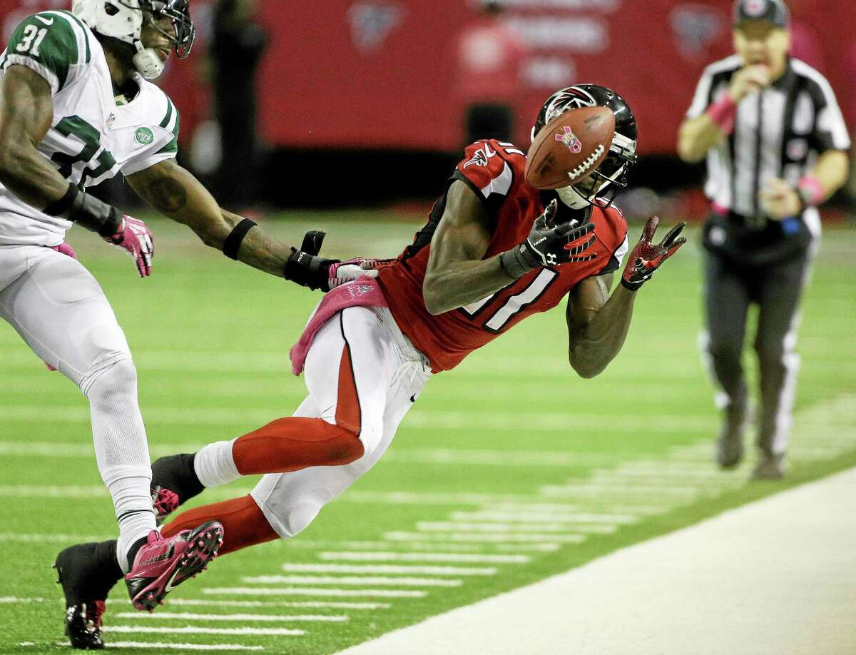 Falcons wide receiver Julio Jones vies for a thrown ball against New York Jets cornerback Antonio Cromartie during Monday's game in Atlanta.