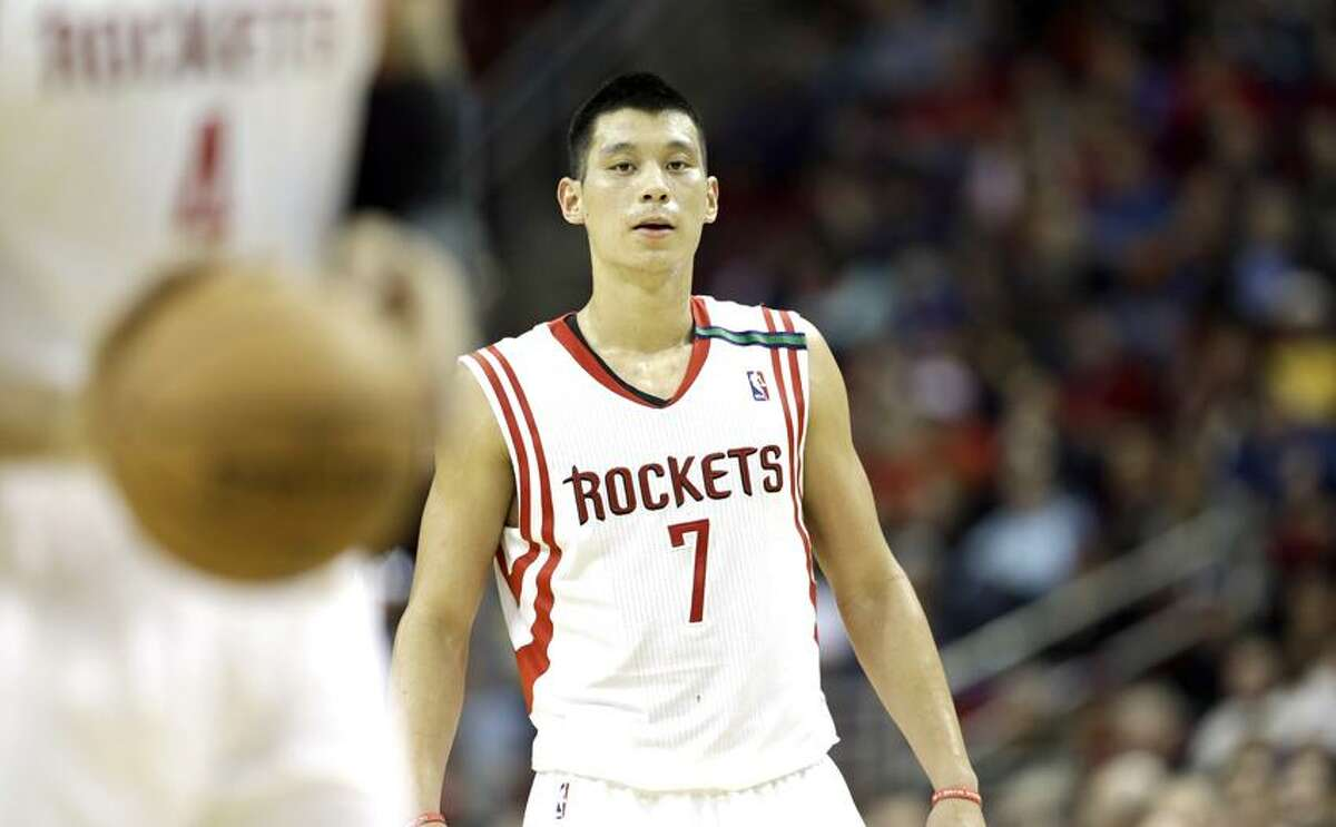 Houston Rockets' Jeremy Lin (7) watches Greg Smith (4) shoot a free throw during the third quarter of an NBA basketball game against the Boston Celtics Friday, Dec. 14, 2012, in Houston. The Rockets beat the Celtics 101-89. (AP Photo/David J. Phillip)