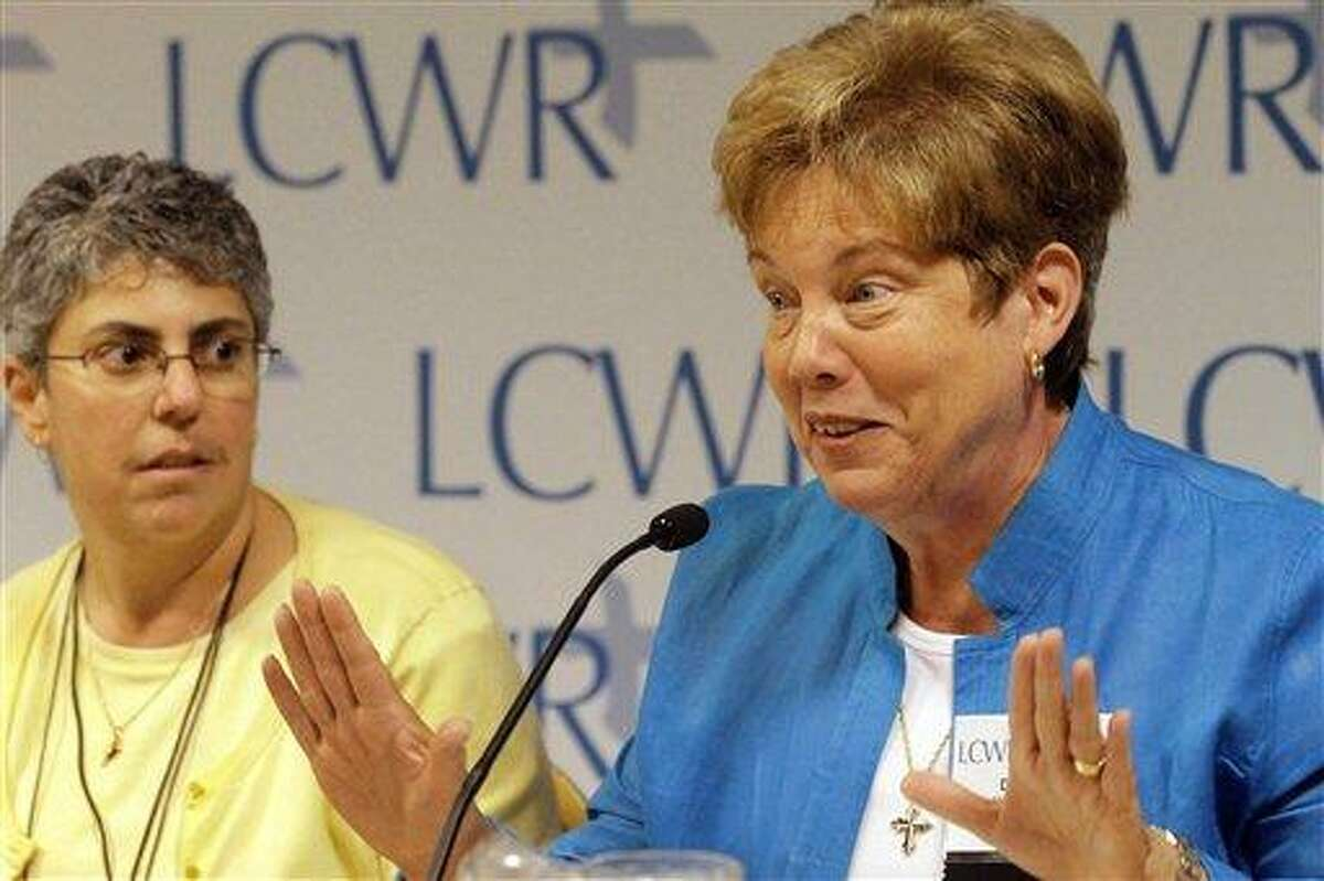 Sister Donna Markham, right, speaks to reporters while Sister Mary Pellegrino looks on during the Leadership Conference of Women Religious(LCWR) assembly Thursday in St. Louis. The LCWR, the largest U.S. group for Roman Catholic nuns, is meeting to decide how they should respond to a Vatican rebuke and order for reform. The LCWR represents about 80 percent of the 57,000 U.S. sisters. (AP Photo/Seth Perlman)