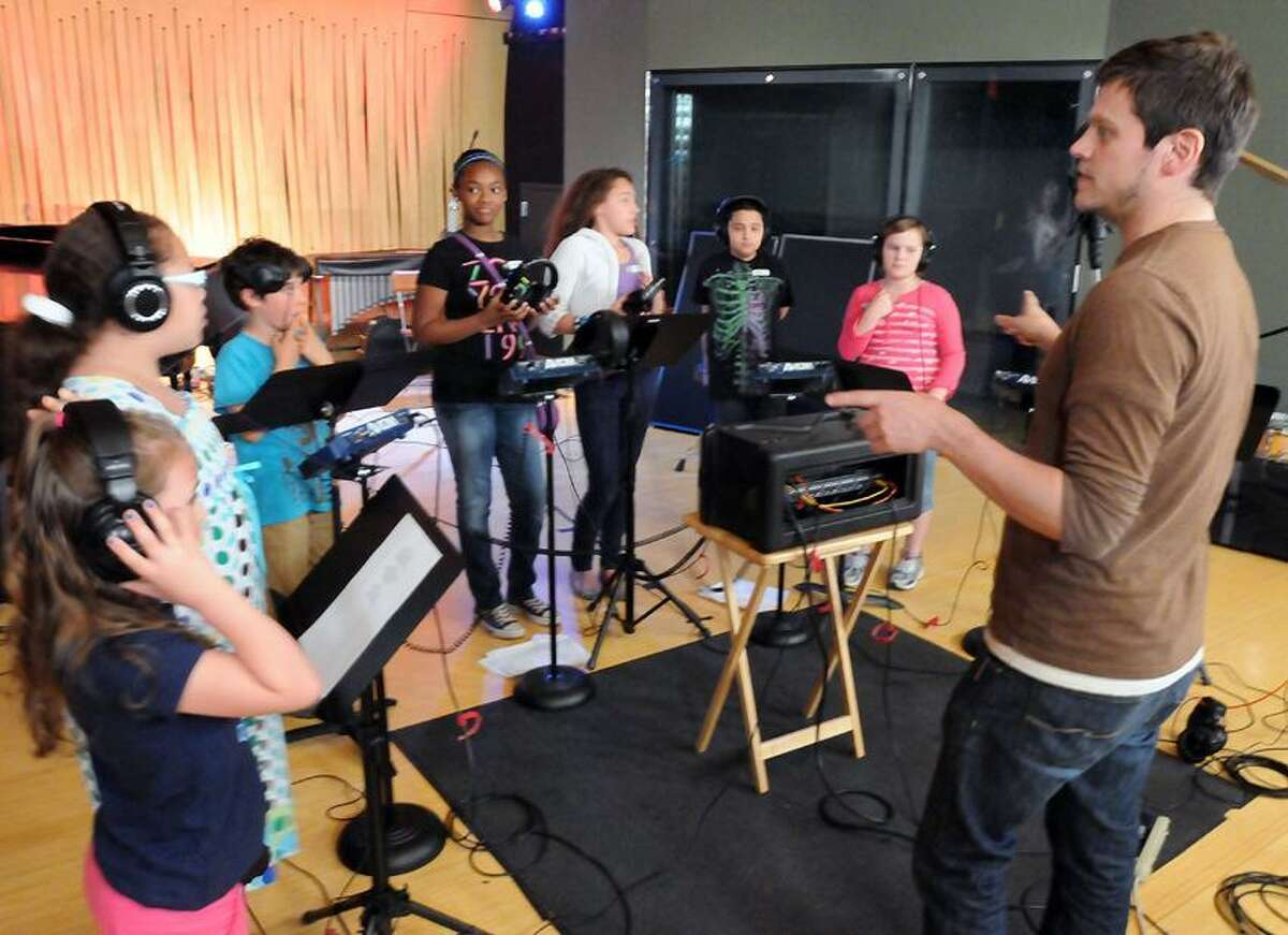 """The studio at Firehouse 12 in New Haven was the site of a recording by Connecticut State Troubadour Chuck Costa of New Haven of """"CT Sings,"""" a project with Connecticut schoolchildren including those here from Falls Village, Norwalk and New Haven. Mara Lavitt/New Haven Register"""