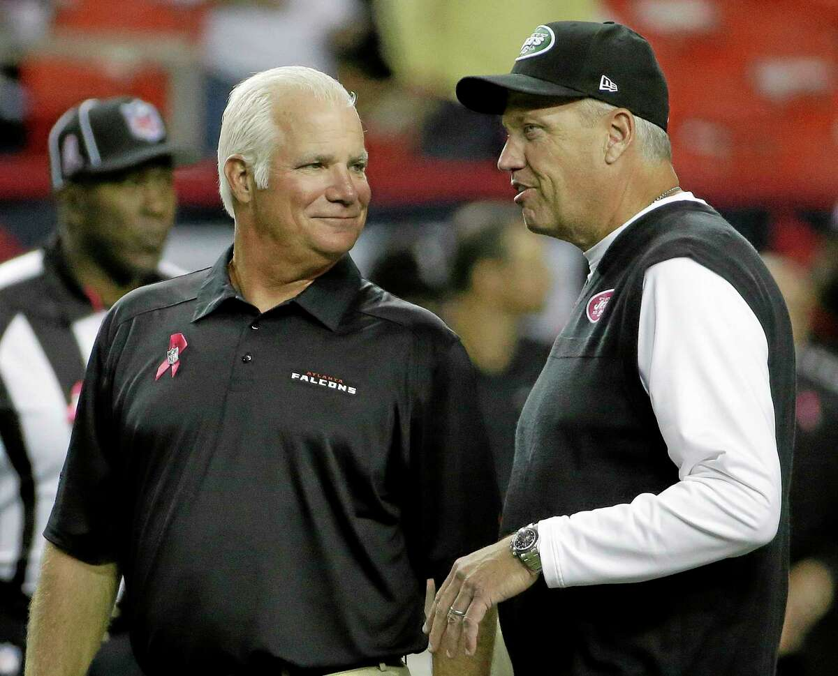 Falcons head coach Mike Smith, left, speaks with New York Jets head coach Rex Ryan before their game Monday night in Atlanta.