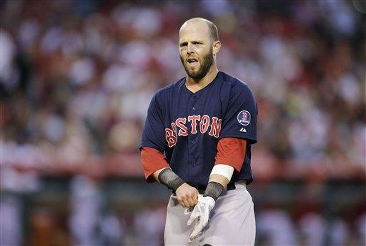 Boston Red Sox's Dustin Pedroia walks toward the dugout after the second inning of a baseball game against the Los Angeles Angels in Anaheim, Calif., Friday, July 5, 2013. (AP Photo/Jae C. Hong)