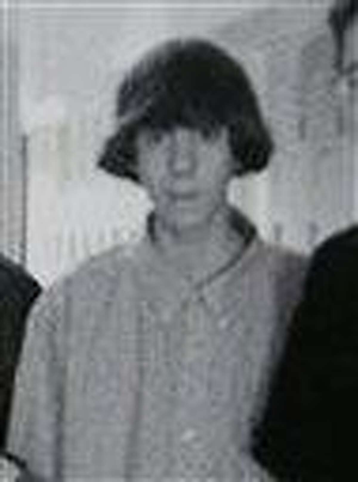 This undated photo shows Adam Lanza posing for a group photo of the technology club which appeared in the Newtown High School yearbook. Authorities have identified Lanza as the gunman who killed his mother at their home and then opened fire Friday, Dec. 14, 2012, inside an elementary school in Newtown, Conn., killing 26 people, including 20 children, before killing himself. Richard Novia, a one-time adviser to the technology club, verified that the photo shows Lanza. (AP Photo)