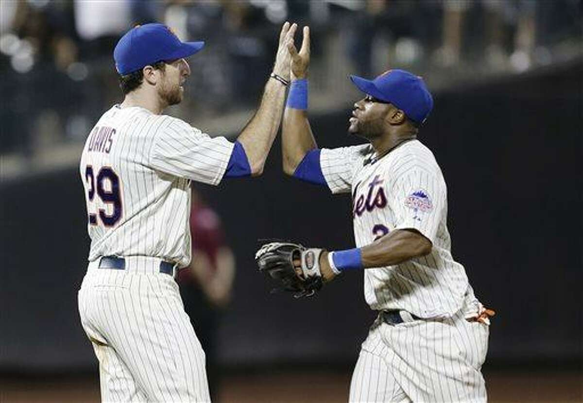 New York Mets' Ike Davis, left, and Eric Young Jr. celebrate after their 4-1 in a baseball game against the Atlanta Braves Tuesday, July 23, 2013, in New York. (AP Photo/Frank Franklin II)