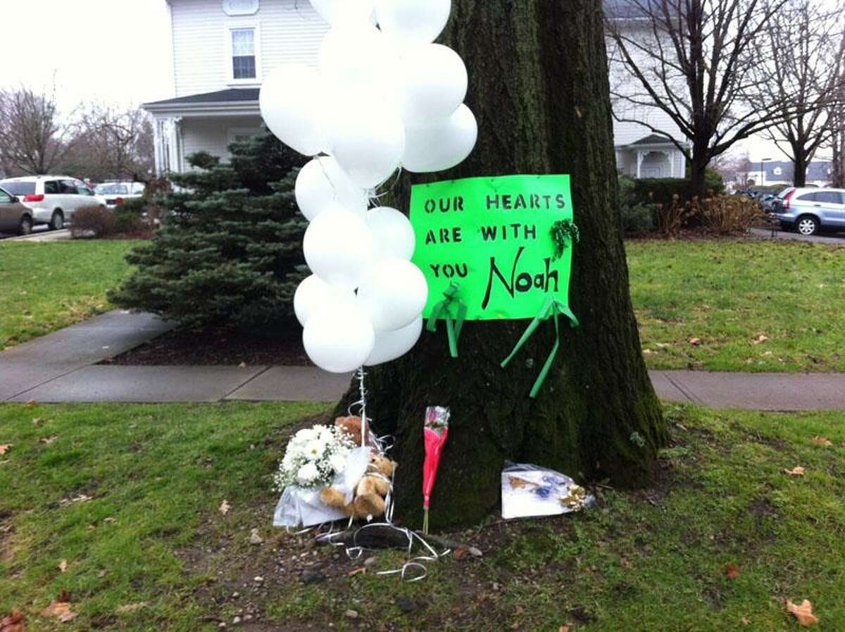 A sign for Newtown shooting victim Noah Pozner, 6, reads