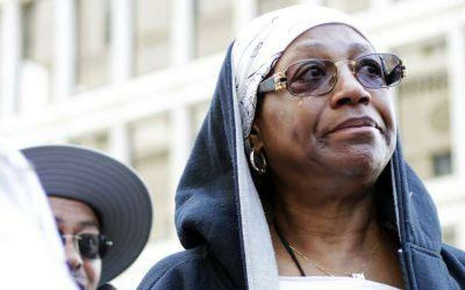 Frances Whiters, 64, of Detroit, sheds a tear while attending the Detroit Chapter of the National Action Network protest of the controversial circumstances surrounding Trayvon Martin's death and the subsequent non guilty verdict of George Zimmerman in downtown Detroit on Saturday, July 20, 2013. Photo: AP / Detroit Free Press