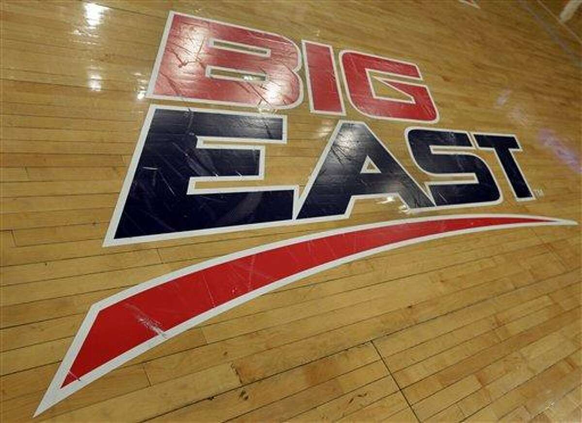 A Big East logo is displayed on the court at Madison Square Garden before an NCAA college basketball game between Marquette and St. John's, Saturday, March 9, 2013, in New York. The conference has reached an agreement with seven departing basketball members that will allow them to separate from the football schools and create their own conference on July 1. Commissioner Mike Aresco told The Associated Press on Friday the seven Catholic schools that are leaving to form a basketball-centric conference will get the Big East name, along with the opportunity to play their league tournament in Madison Square Garden.(AP Photo/Richard Drew)
