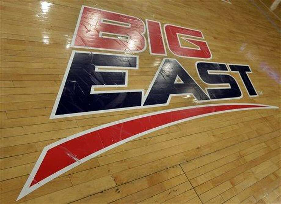 A Big East logo is displayed on the court at Madison Square Garden before an NCAA college basketball game between Marquette and St. John's, Saturday, March 9, 2013, in New York. The conference has reached an agreement with seven departing basketball members that will allow them to separate from the football schools and create their own conference on July 1. Commissioner Mike Aresco told The Associated Press on Friday the seven Catholic schools that are leaving to form a basketball-centric conference will get the Big East name, along with the opportunity to play their league tournament in Madison Square Garden.(AP Photo/Richard Drew) Photo: ASSOCIATED PRESS / AP2013
