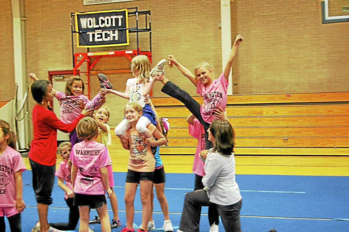 Cheerleaders in the Torrington Warriors youth cheerleading program practice for a conference competition coming up.