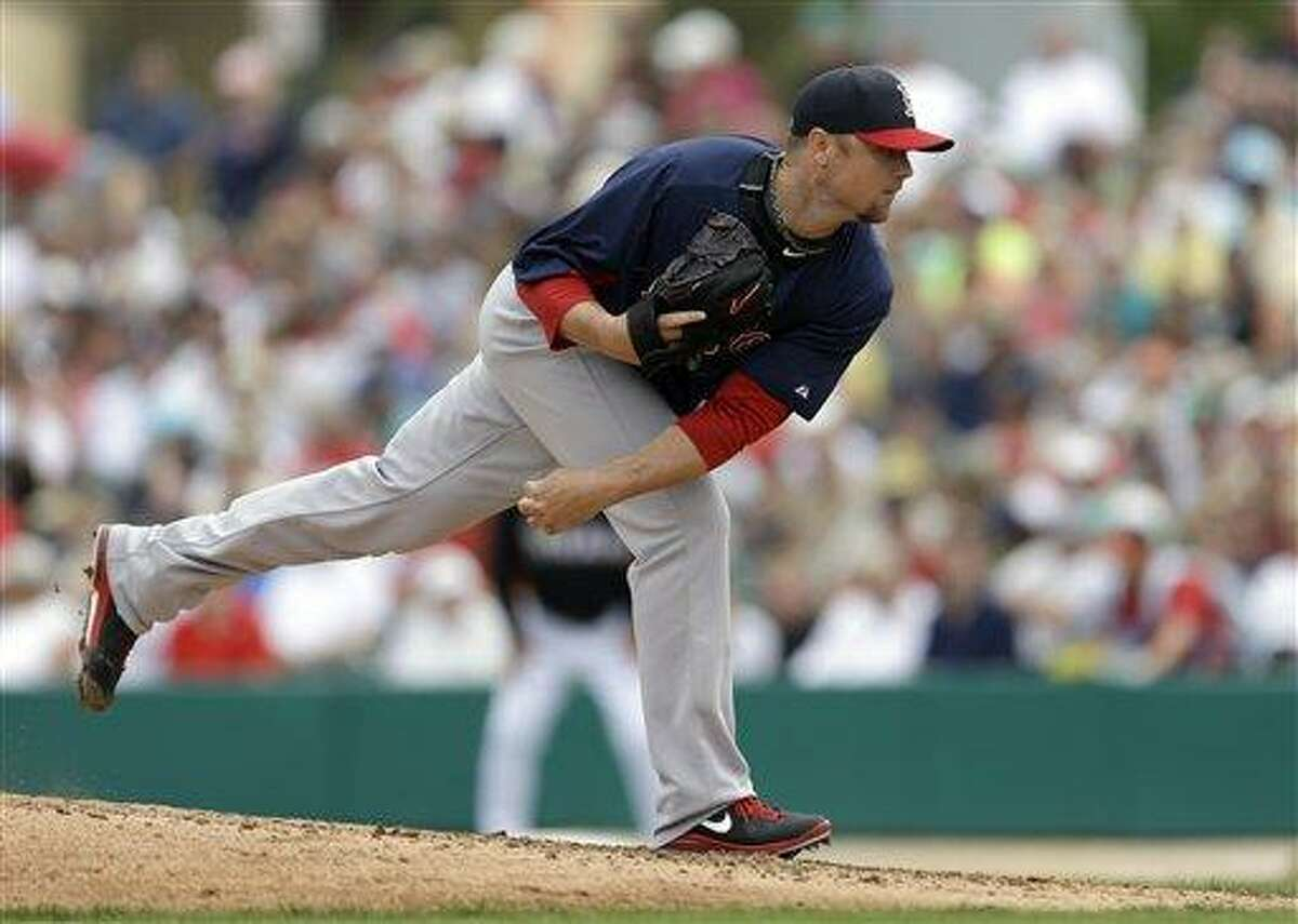 Boston Red Sox starting pitcher Jon Lester throws during an exhibition spring training baseball game against the Miami Marlins Monday, March 11, 2013, in Jupiter, Fla. (AP Photo/Jeff Roberson)