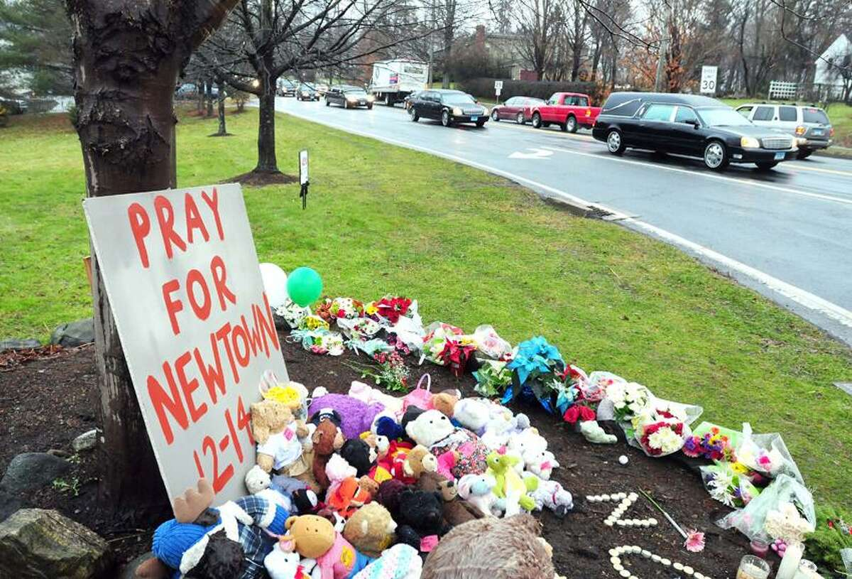 The funeral procession for six-year-old Jack Pinto, a victim of the Sandy Hook Elementary School shootings, travels down Main St. in Newtown on 12/17/2012.Photo by Arnold Gold/New Haven Register