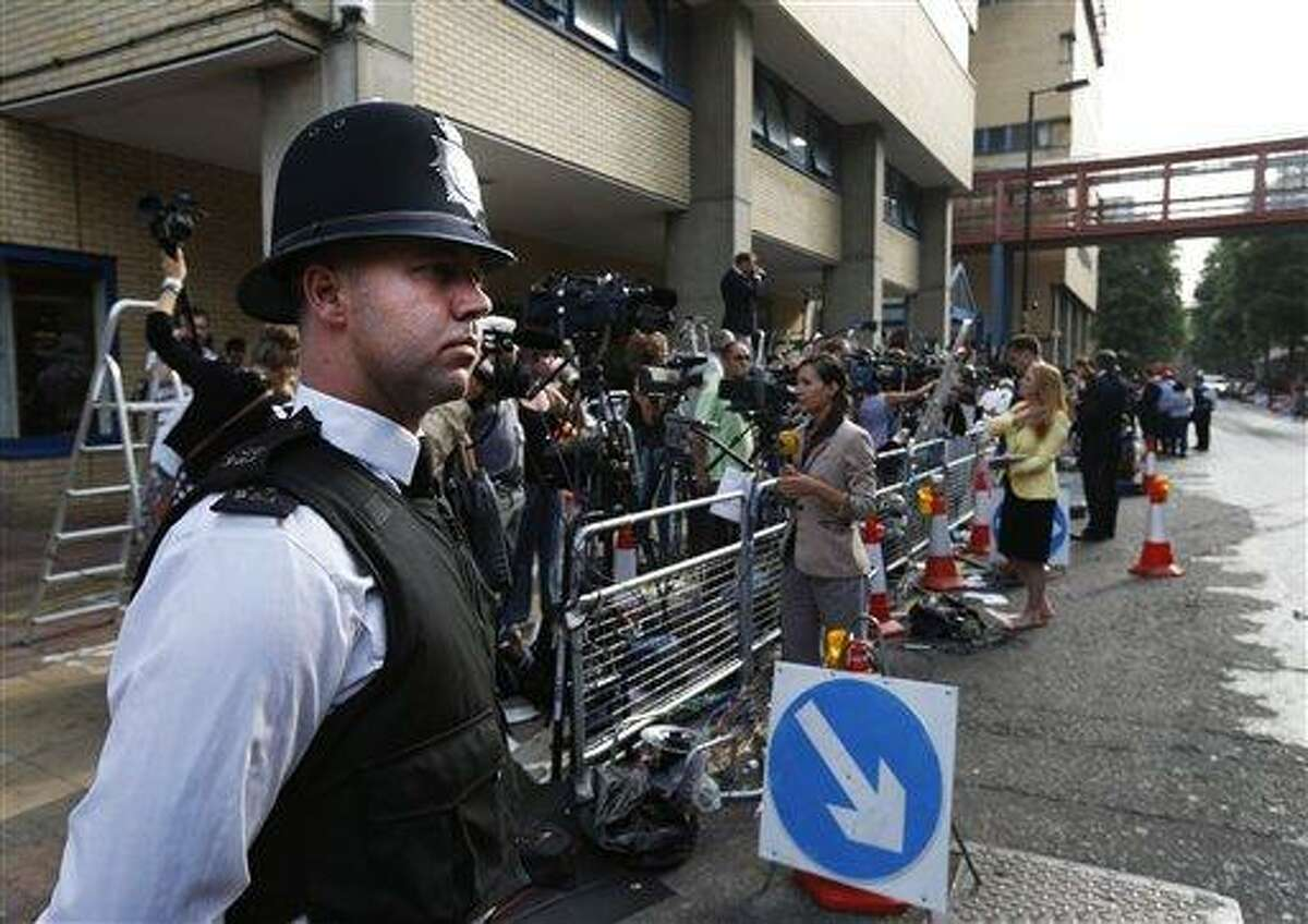 Backdropped by members of the media, a British police officer stands across the entrance of St. Mary's Hospital exclusive Lindo Wing in London, Monday, July 22, 2013. Buckingham Palace officials say Prince William's wife, Kate, has been admitted to the hospital in the early stages of labour. Royal officials said that Kate traveled by car to St. Mary's Hospital in central London. Kate _ also known as the Duchess of Cambridge _ is expected to give birth in the private Lindo Wing of the hospital, where Princess Diana gave birth to William and his younger brother, Prince Harry.The baby will be third in line for the British throne _ behind Prince Charles and William _ and is anticipated eventually to become king or queen. (AP Photo/Lefteris Pitarakis)