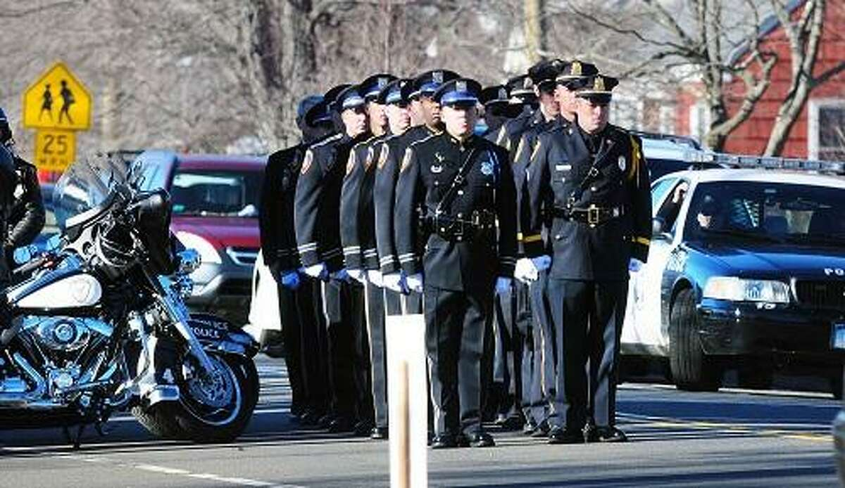A contingent of police honor guard stand in formation at the Lordship Community Church in Stratford during the funeral service of Victoria Soto on 12/19/2012.Photo by Arnold Gold/New Haven Register