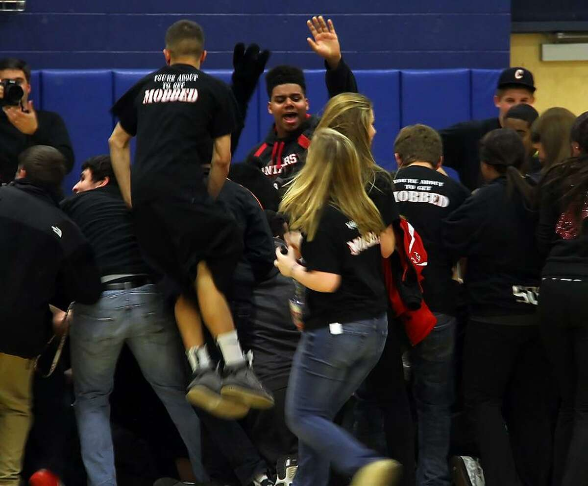Joe Pelletier/The Middletown Press Cromwell High students rush the court to celebrate their team's win against Weaver in the Class M state tournament semifinals. The Panthers will meet Notre Dame-Fairfield in the title game this weekend, time to be announced.