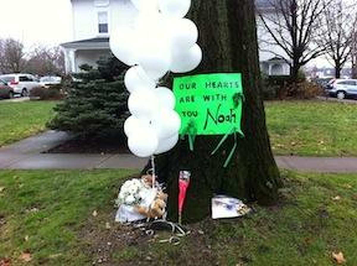 """A sign for Newtown shooting victim Noah Pozner, 6, reads """"Our hearts are with you Noah"""" in Fairfield Monday. Peter Casolino/New Haven Register"""