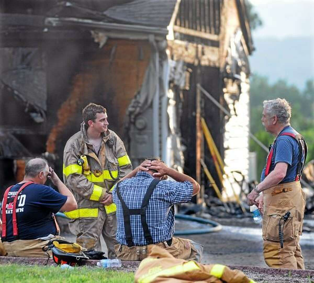 Catherine Avalone - The Middletown Press Firefighters from Middlefield, Durham, South Fire District, Middletown and Westfield on the scene of a house fire at 329 Cherry Hill Road in Middlefield. Police said the fire started as a result of a car parked in the garage of the colonial home.