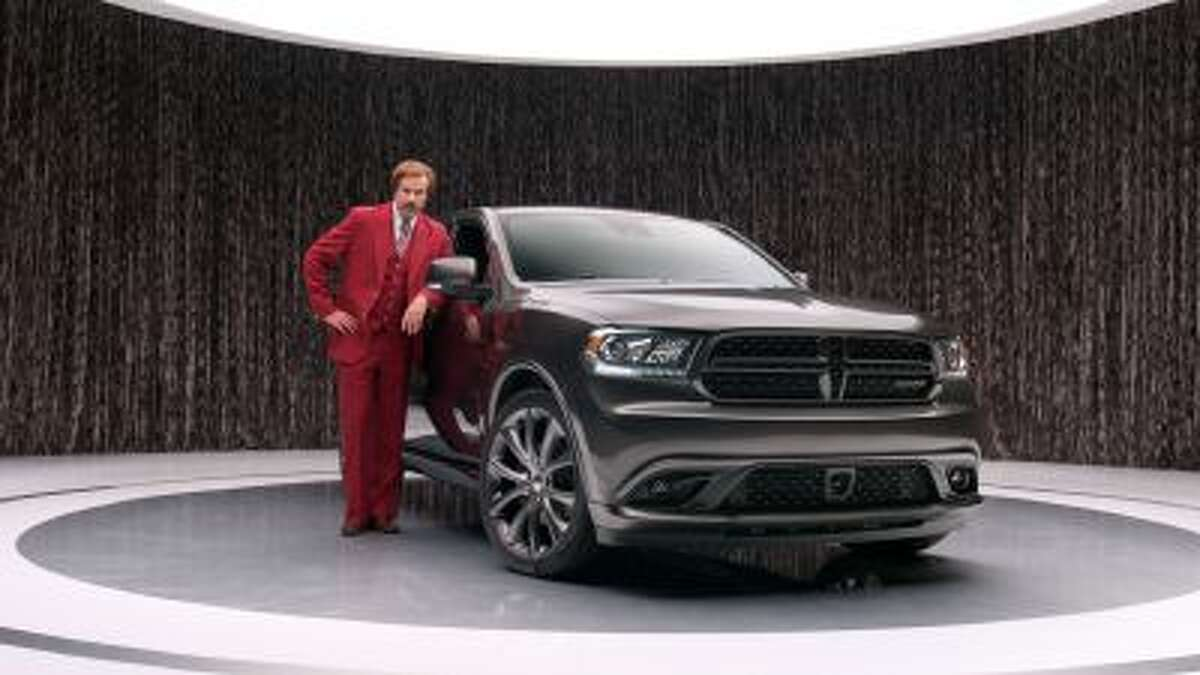 """This undated photo provided by Chrysler shows Will Ferrell as """"anchorman"""" character Ron Burgundy in an advertisement for the 2014 Dodge Durango."""