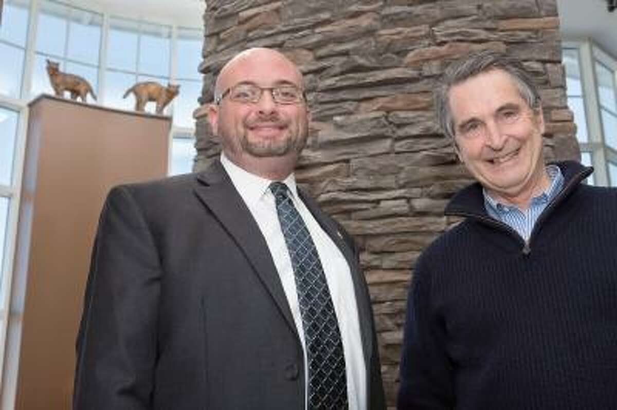 Daniel Brown (left), director of the Carl Hansen Student Center, with Jefferson Riley of Centerbrook Architects. Centerbrook donated a series of Bobcat statuettes that now overlook the newly renovated Carl Hansen Student Center on Quinnipiac University's Mount Carmel Campus. February 21, 2013.