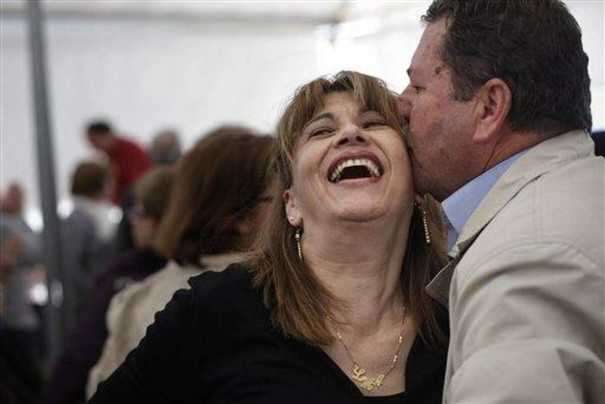 A couple kiss after a dance during a meeting between men and women Saturday at the village of Candeleda, central Spain. A total of 68 women were bussed in to the village to meet with the local men with the hope that some will form relationships and settle in the village where the main population is male. Associated Press