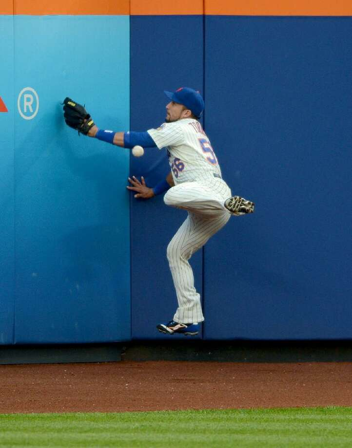 ASSOCIATED PRESS New York Mets' Andres Torres can't catch a ball hit to center field by the Miami Marlins' John Buck that went for a double in the second inning of Wednesday night's game in New York. The Mets lost 13-0.