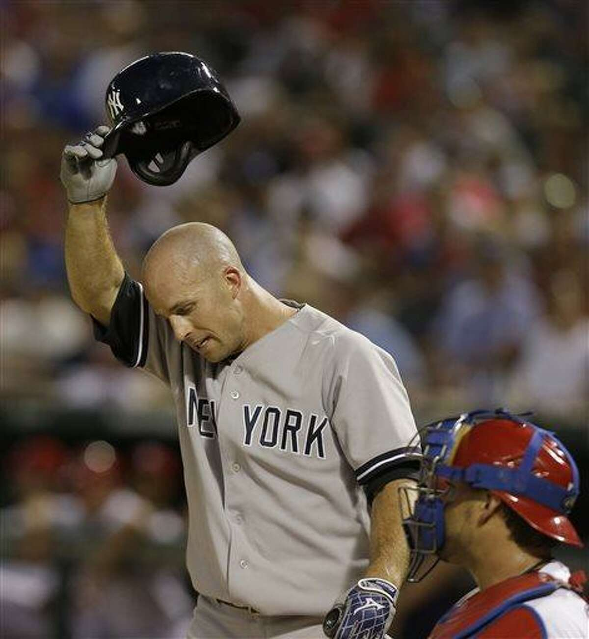 New York Yankees Brett Gardner takes off his helmet during his at bat during the ninth inning of a baseball game against the Texas Rangers Monday, July 22, 2013, in Arlington, Texas. The Ranges won 3-0. (AP Photo/LM Otero)