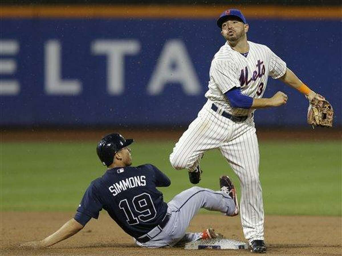 New York Mets shortstop Omar Quintanilla (3) reacts after forcing out Atlanta Braves shortstop Andrelton Simmons (19) when Jason Heyward reached on an eighth-inning, fielder's choice in a baseball game Monday, July 22, 2013, in New York. (AP Photo/Kathy Willens)