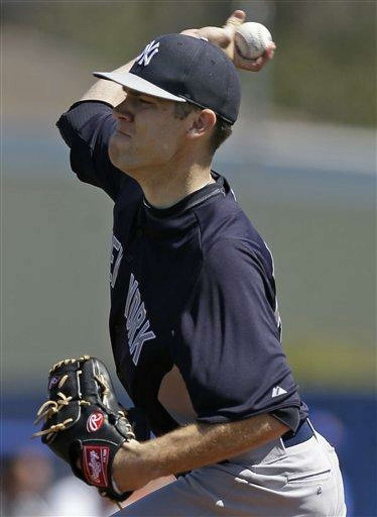 REMOVES REFERENCE TO STEINBRENNER FIELD - New York Yankees relief pitcher David Phelps (41) delivers in the fifth inning against the Toronto Blue Jays in a spring training baseball game in Dunedin, Fla., Sunday, March 10, 2013. (AP Photo/Kathy Willens)