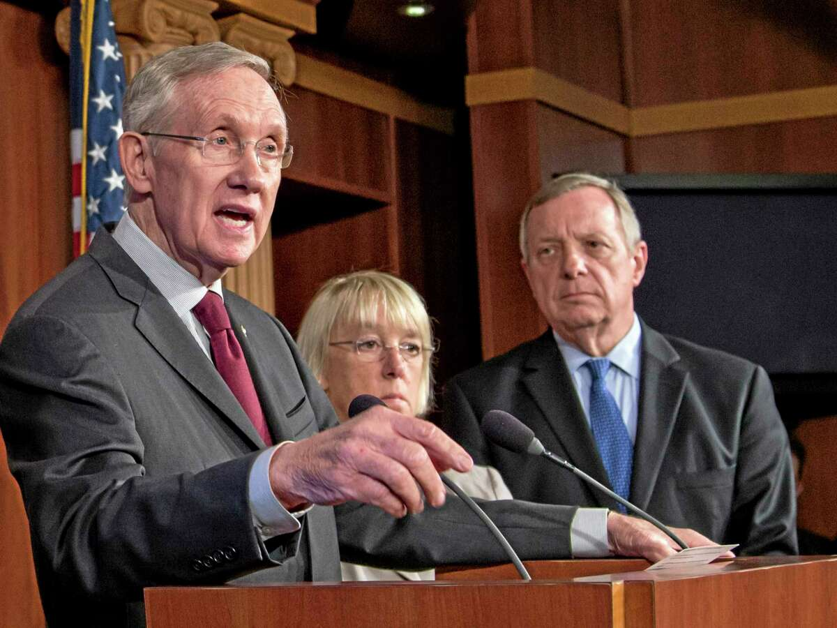FILE - This Sept. 30, 2013 file photo shows, from left, Senate Majority Leader Harry Reid of Nev., Senate Budget Committee Chair Sen. Patty Murray, D-Wash. and Senate Majority Whip Richard Durbin of Ill. during a news conference on Capitol Hill in Washington. President Barack Obama and Senate Democrats are mocking Rep. Marlin Stutzman, R-Ind. for saying Republicans should get something from the budget standoff — but he doesn't know what that is. (AP Photo/J. Scott Applewhite, File)
