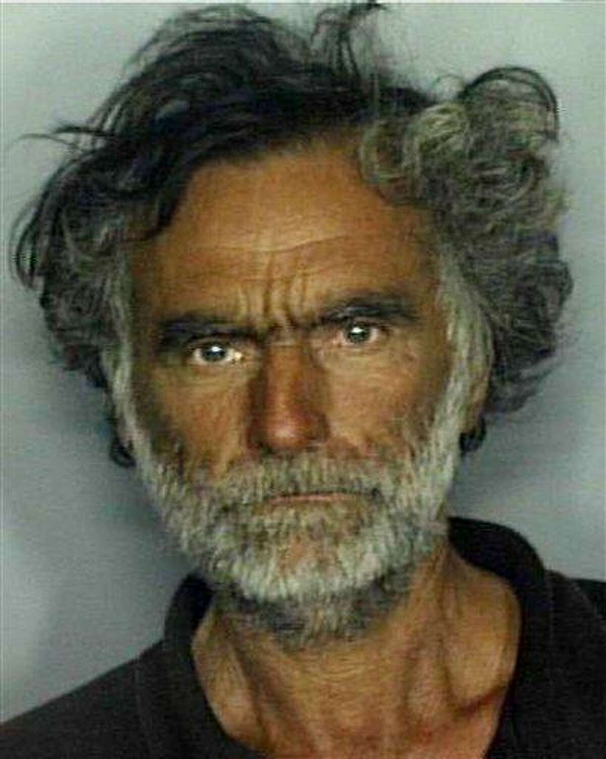 This undated booking file photo made available by the Miami-Dade Police Dept. shows Ronald Poppo. In a recorded July 19 interview, Ronald Poppo told investigators the man who approached him initially seemed friendly. But Poppo said Rudy Eugene then