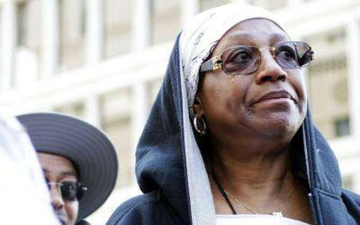 Frances Whiters, 64, of Detroit, sheds a tear while attending the Detroit Chapter of the National Action Network protest of the controversial circumstances surrounding Trayvon Martin's death and the subsequent non guilty verdict of George Zimmerman in downtown Detroit on Saturday, July 20, 2013.