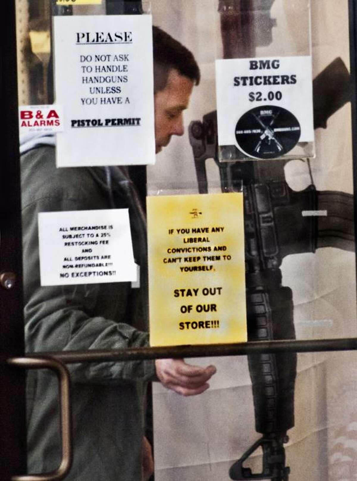 A man walks into BMG gun shop, in Newington. Melanie Stengel/Register